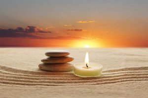 stack of stones and candle light
